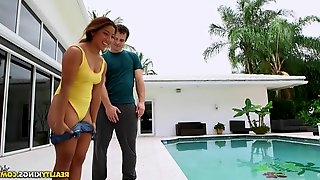 Poolside penetration session for the tanned goddess with a shaved slit