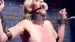 Housewife gagged in metal stock whipped