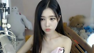 Asian tiny camgirl plays with her nice pussy