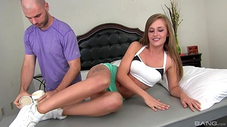Nude cutie April Brookes gets massaged and sucks a large dick