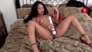 Tattooed MILF moans while pleasuring her cunt with a vibrator